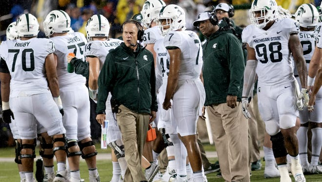 Michigan State  head coach Mark Dantonio yells out to the team after a penalty after an interception during the third quarter on Saturday, Oct. 7, 2017, at Michigan Stadium in Ann Arbor.