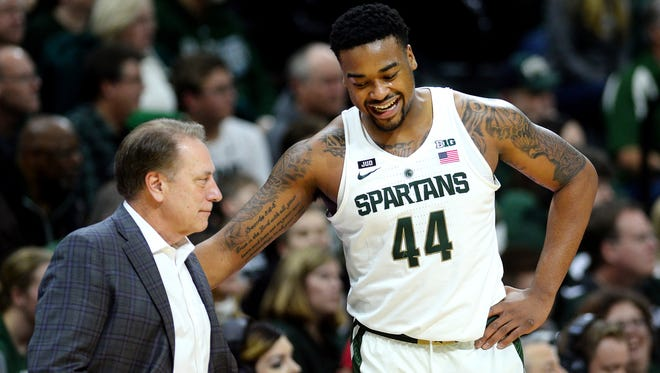 Michigan State's Nick Ward, right, jokes with head coach Tom Izzo after being taken out late during the second half on Friday, Dec. 29, 2017, at the Breslin Center in East Lansing. The Spartans won 111-61.