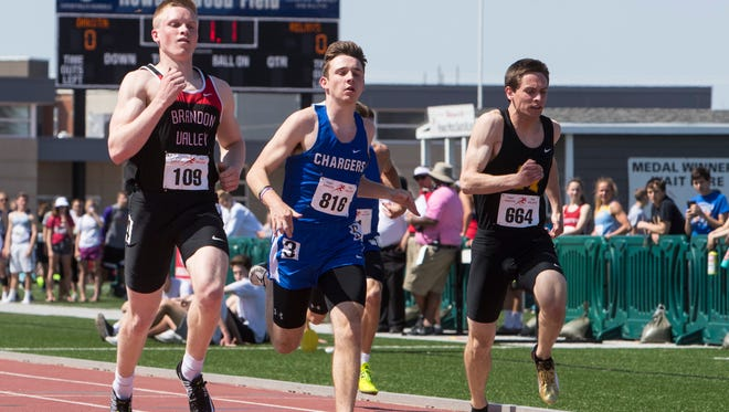 Brandon Valley Braiden Petersen, left and Sioux Falls Christian Parker Nelson and Mitchell High School Courtney Miller participate in the high school boys 100 prelims during the Howard Wood Dakota Relays on Friday, May 4, 2018, at Howard Wood Field in Sioux Falls.