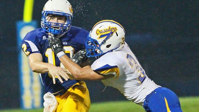 Catholic Memorial #34 CJ Goetz hits Germantown quarterback Nate Seymour.