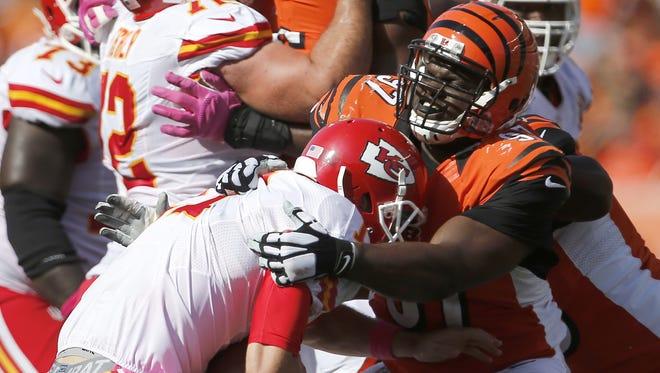 Cincinnati Bengals defensive tackle Geno Atkins sacks Kansas City Chiefs quarterback Alex Smith on Sunday.