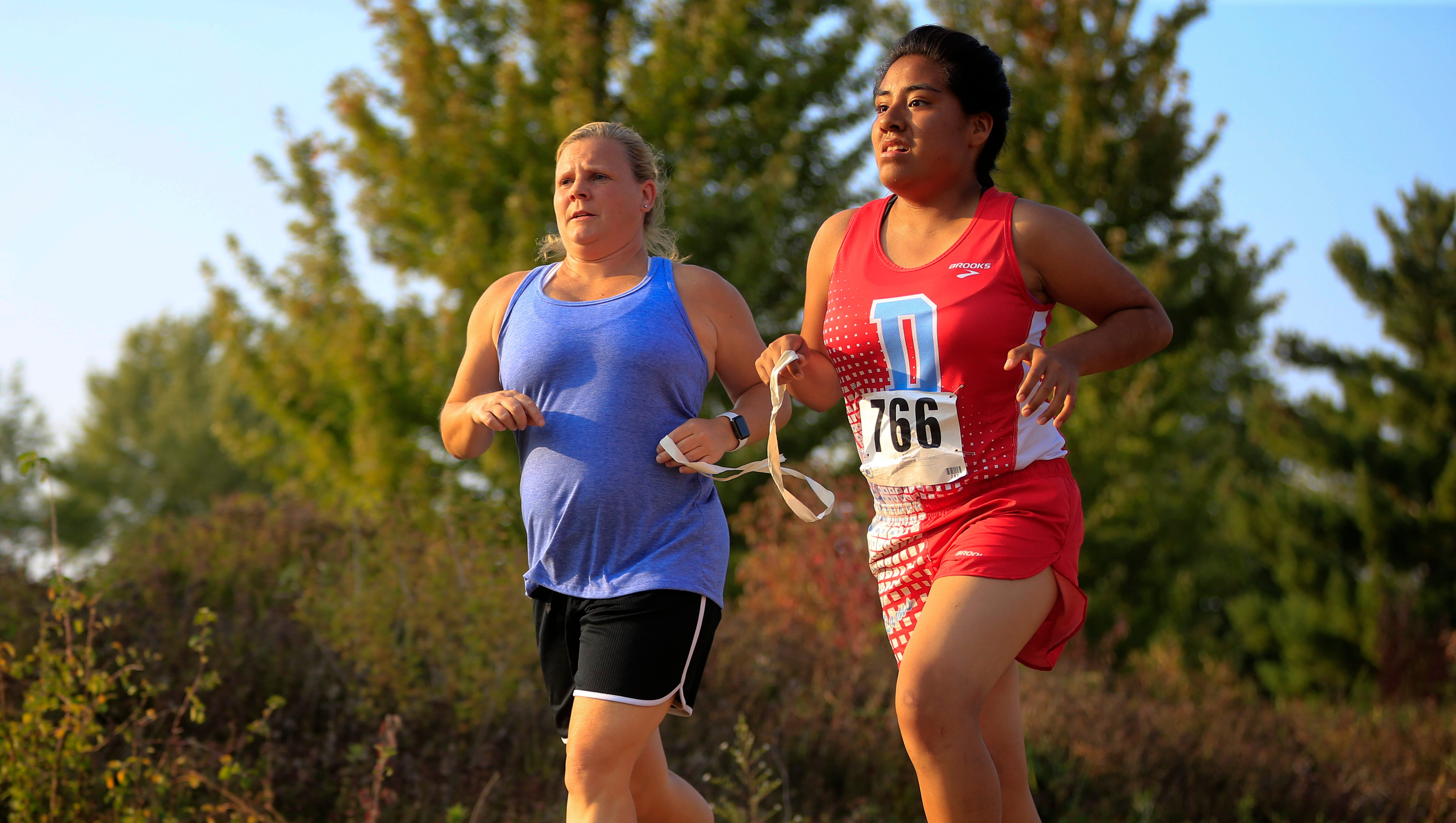 Blind Iowan joins cross country team, finds bliss on the track