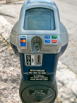 A Phoenix parking meter that accepts credit cards as well as coins sits in downtown Phoenix.