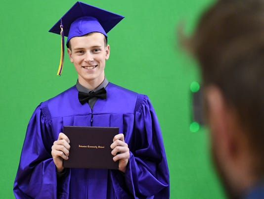 636318345828588945-des.urb0602-johnston-grad11.JPG