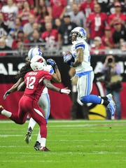 Safety Glover Quin has seven interceptions last season, but this one was called back because of a penalty.