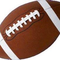 Three footballs on turf