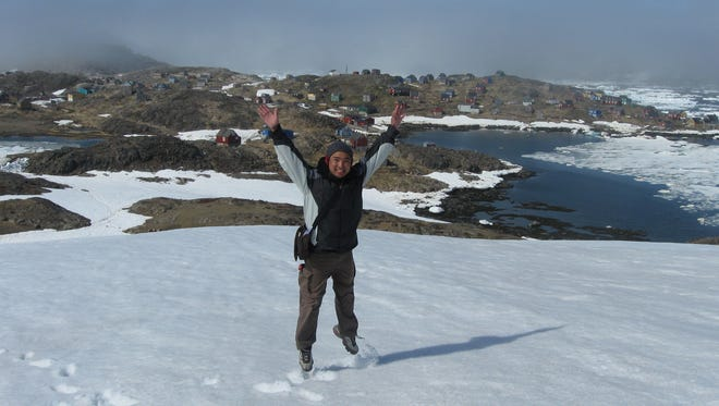 Norman Nazareth jumping on the snow in front of Kulusuk, Greenland (population 300).