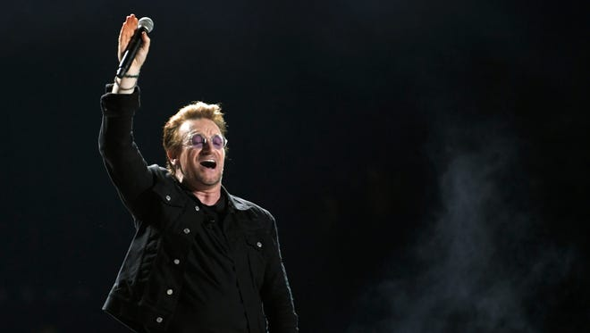 U2's Bono performs on the What Stage during the headliner performance at the Bonnaroo Music and Arts Festival in Manchester, Tenn, June 9, 2017.