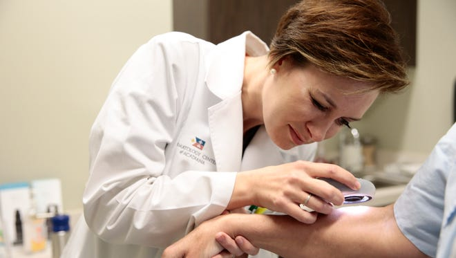 Dr. Kristy R. Kennedy performs a skin exam at  Dermatology Center of Acadiana in Lafayette May 10 , 2016.