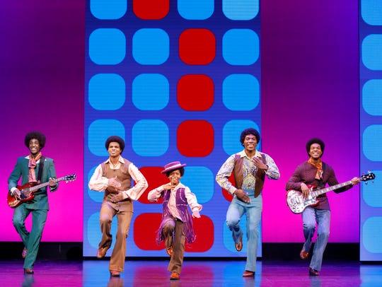 Kai Calhoun as Michael Jackson (center) with the Jackson