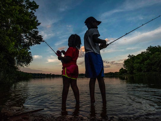 Siblings fish together at Cooters Pond in Prattville,