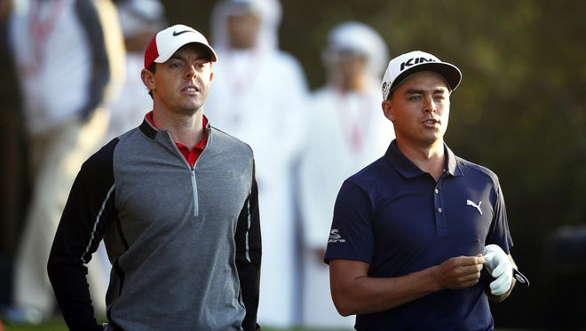 Rory McIlroy (L) of Northern Ireland and Rickie Fowler (R) of the USA during the first round of the Abu Dhabi HSBC Golf Championship 2016 at Abu Dhabi Golf Club in Abu Dhabi, United Arab Emirates, 21 January 2016.
