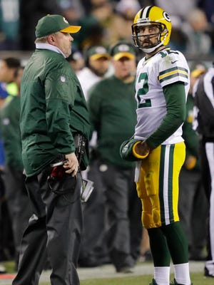 Green Bay Packers quarterback Aaron Rodgers talks with Mike McCarthy in the second quarter against the Philadelphia Eagles at Lincoln Financial Field.