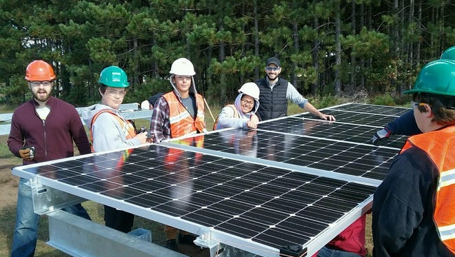 CWSA students install solar panels during the 2016-17 school year.