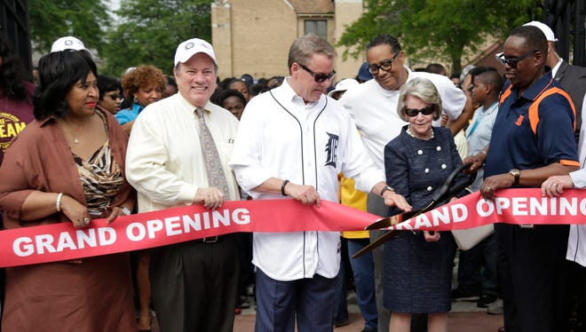 From left, Detroit City Council president Brenda Jones, Detroit Mayor Mike Duggan, Ford Motor Company Executive Chairman Bill Ford, Martha Firestone Ford and UAW-Ford Vice President Jimmy Settles participate in the ribbon cutting ceremony for William Clay Ford Field, the newly renovated UAW-Ford/ Detroit Neighborhoods community ballpark.