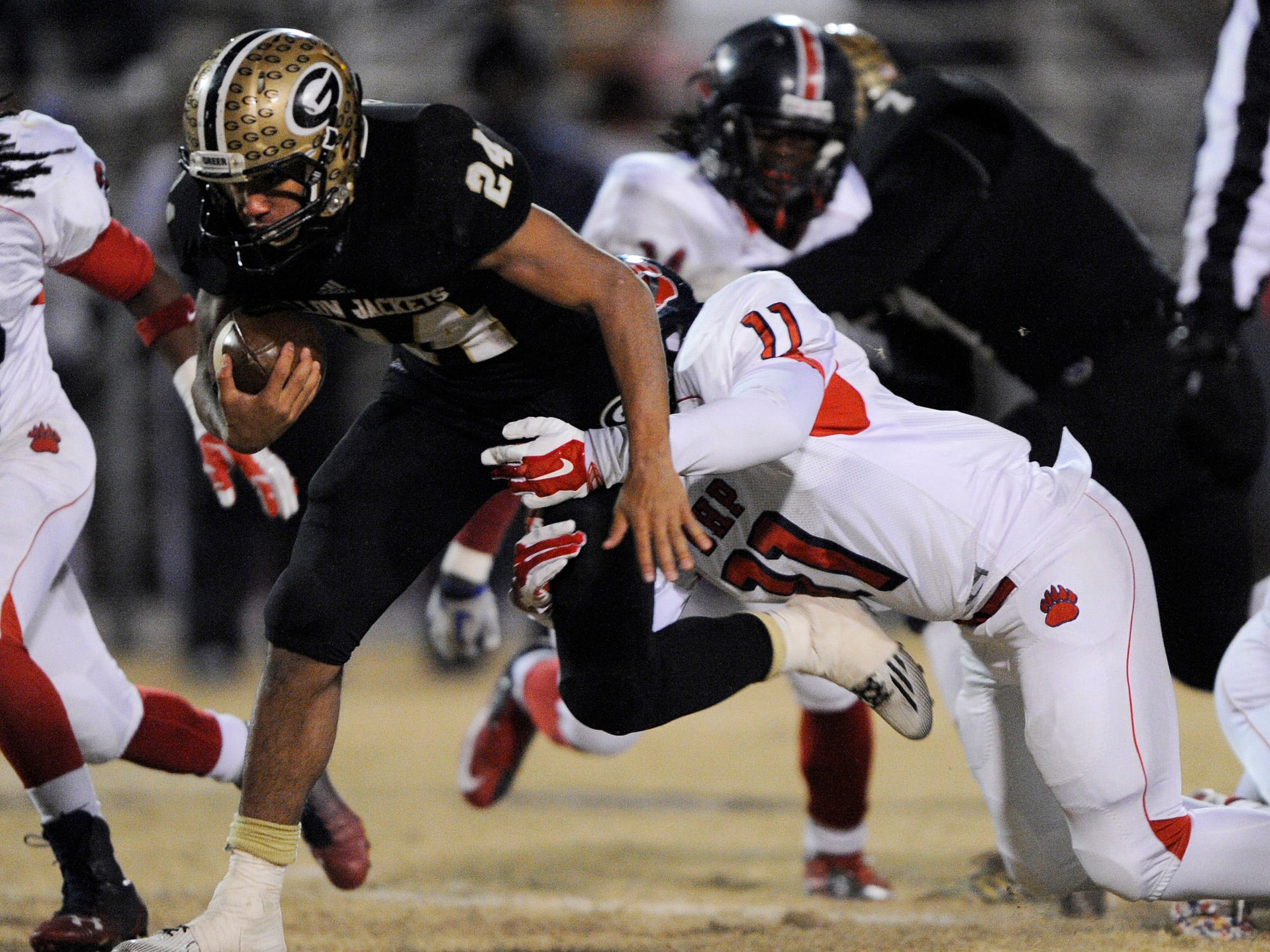 Greer's Adrian McGee (24) is caught by B-HP's TC Mccullough (11).