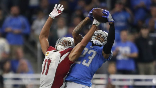 Darius Slay breaks up a pass to the Cardinals' Larry Fitzgerald in the fourth quarter of the Lions' 35-23 win Sunday, Sept. 10, 2017 at Ford Field.