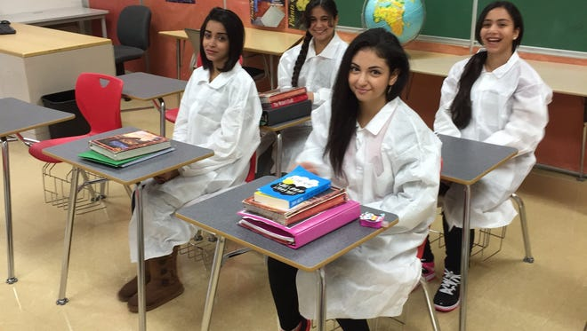 Wilkinson Middle School eighth-graders whose experiments were on board the Antares rocket that exploded at launch Oct. 28, 2014, are, front row from left, Farah Sabah, 14, and Regina Alsabagh, 14; and back row, from left, Israa Alfadhli, 13, and Maryam Kafra, 13.