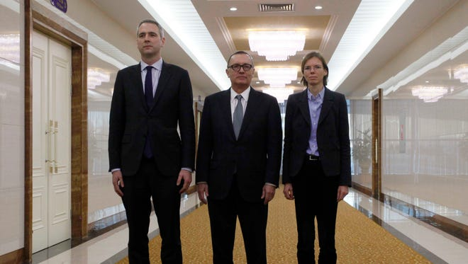 U.N. Undersecretary-General for Political Affairs Jeffrey Feltman, center, poses with two unidentified accompanying colleagues upon arrival at the Pyongyang International Airport in Pyongyang, North Korea, Tuesday, Dec. 5, 2017.