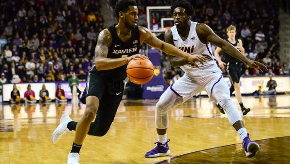 Xavier Musketeers guard Trevon Bluiett (5) goes to the basket as Northern Iowa Panthers guard Tywhon Pickford (4) defends during the first half at McLeod Center.