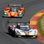 Christian Fittipaldi steers the No. 5 Action Express Racing Corvette DP through Turn 6 at Watkins Glen International during Sunday's Sahlen's Six Hours of The Glen. Fittipaldi and Joao Barbosa teamed to win the event overall.