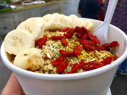 An acai bowl with bananas, granola, goji berries, hemp seed and bee pollen.