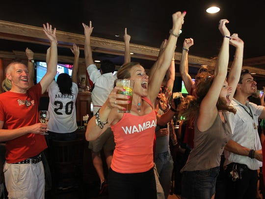 Kara Burdick (front) and other fans celebrate Abby Wambach's go-ahead goal in a 2011 World Cup semifinal. A large Wambach following turned out at  the Back Nine Grill in Pittsford to watch the game.