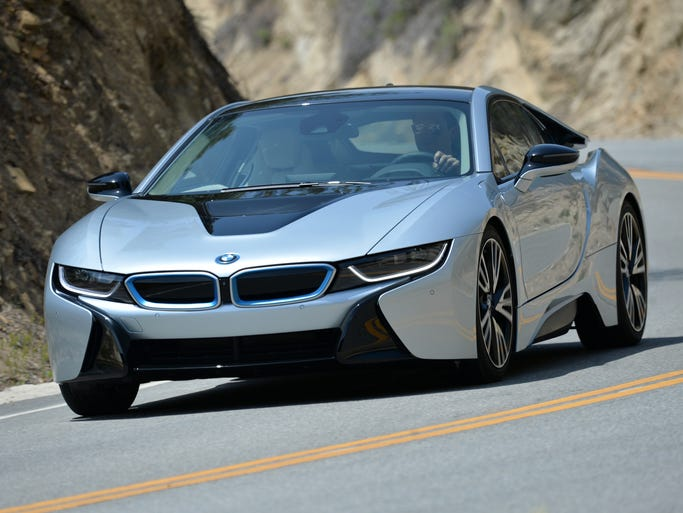 The BMW i8 plug-in hybrid with three-cylinder gas engine plus electric motor good for 362 combined horsepower, 0-60 mph in 4.5 seconds and an estimated overall fuel rating of 60-70 mpg. It goes on sale this year starting at $135,700 plus shipping.