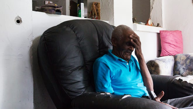 """Will Davis, 92,  a 50 year resident of a home on Davis Court in Dunbar sits in his recliner next to the site where a bullet from Wednesday's shooting entered his home.  He was in bed at the time of the shooting but would have been in the line of fire if the shooting happened during the daytime.  He said """"I am not going to let these people run me off."""""""