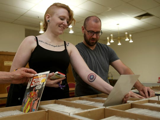 Lacie Wallace and Lee Bishop look through comic books at the Willamette Valley Collector's Market on Sunday in Salem, Ore.