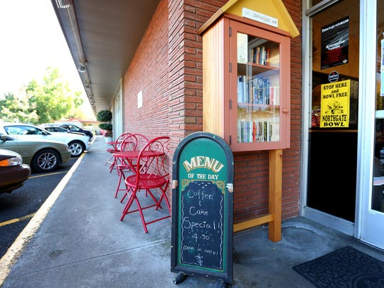 A Little Free Library is outside the entrance of Breakpoint Coffee in Salem.