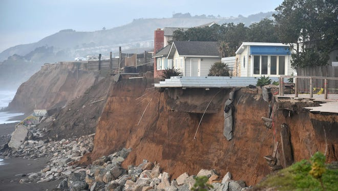Sections of land are seen missing from coastal properties in Pacifica, Calif., on Jan. 26, 2016. Storms and powerful waves caused by El Nino have been intensifying erosion along nearby coastal bluffs and beaches in the area. Another El Nino is forecast for the coming winter.