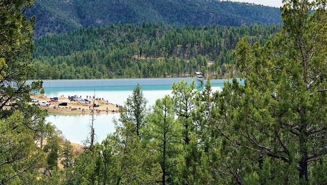 A warm spring day brought out hikers above Grindstone Reservoir who snapped photos of families fishing at the lake.