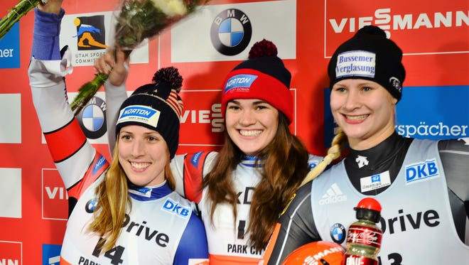 Summer Britcher, center, celebrates her victory in the Sprint World Cup in Park City, Utah last week. Her second World Cup win in as many days allowed her to take the lead in the World Cup overall standings. Erin Hamlin, second place, and Germany's Dajana Eitberger, third, joined her on the podium.