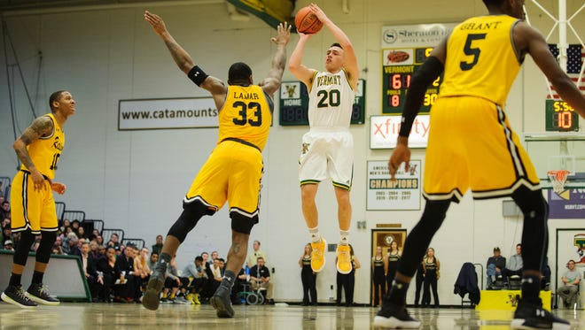 Vermont's Ernie Duncan (20) shoots a 3-pointer in a men's college basketball game at Patrick Gym on Jan. 6. UVM (15-5 overall, 5-0 in America East play) has won eight in a row entering Sunday's game at Hartford.