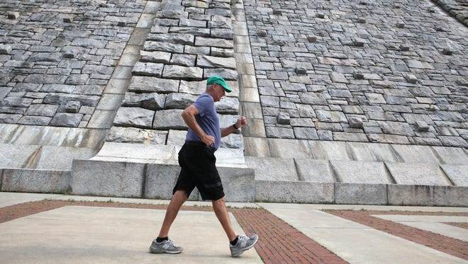 Scarsdale resident Tom Kline, who has walked thousands of miles on five continents for causes, trains at Kensico Dam Plaza, May 13, 2015 in Valhalla.