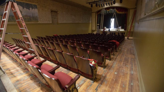 Work crews complete the final touches on the Electric Theater remodeling and expansion Wednesday, Aug. 26, 2015.