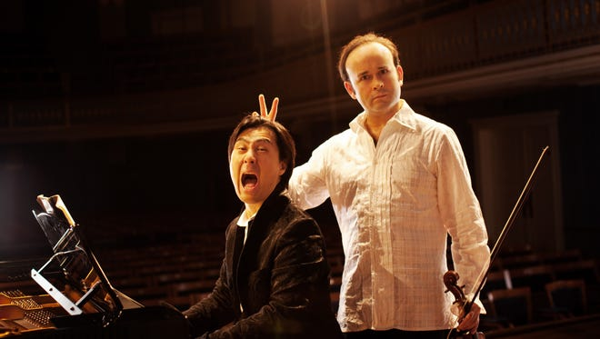 Hyung-ki Joo, left, and Aleksey Igudesman, right, of the classical music comedy duo Igudesman & Joo.
