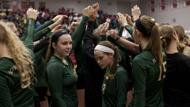 Iowa City West cheers at the beginning of the high school girls volleyball 5A Region 7 final at Linn-Mar High School in Marion, Iowa on Tuesday, November 3, 2015.