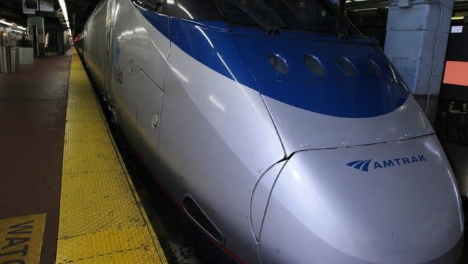 Passengers board Amtrak's Acela train.
