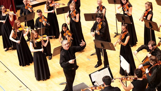 George Thomson conducts West Salem's string orchestra in the OSAA Orchestra State Championships at the LaSells Stewart Center at Oregon State University in Corvallis on Thursday, May 12, 2016. West's strings placed second. West's symphony placed first.