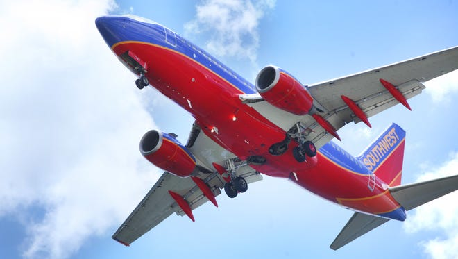 In a June 6, 2016, photo, a Southwest Airlines jet gets ready to land at Tampa International Airport, in Tampa, Fla. Two major unions at Southwest Airlines are demanding that the carrier replace CEO Gary Kelly because of the technology outage that caused the airline to cancel or delay thousands of flights in July. The unions representing pilots and mechanics said Monday, Aug. 1, 2016, that Southwest is spending too much on buying back shares and not enough on updating its technology.