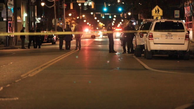 Rochester police investigate a double shooting that left one Rochester man dead, and another man at Strong Memorial Hospital with non-life-threatening injuries at the intersection of Jefferson and Frost Avenues on Monday, Nov. 7, 2016.