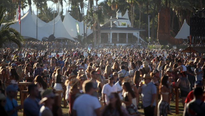 Country music fans attend the Stagecoach Country Music Festival at Empire Polo Club.
