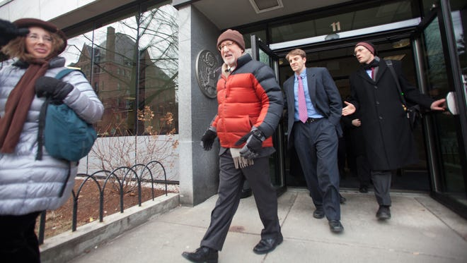 Center, attorney Larry Robbins, representing Vermont, leaves federal court in Burlington on Wednesday after the first part of a hearing where he defended the state's right to require GMO labeling.