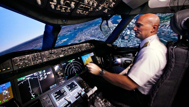 Pilot Gregg Pointon operates a Boeing 787 full-flight simulator on Aug. 26, 2010, in Renton, Wash.