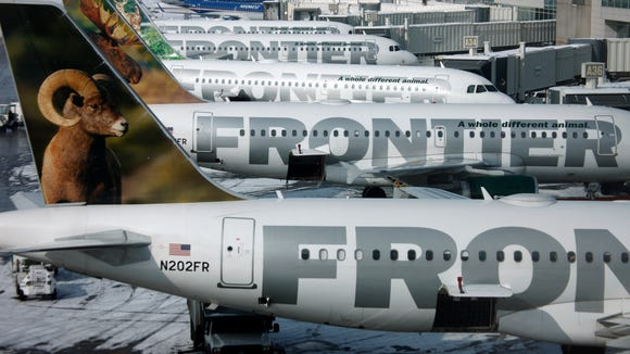 Frontier Airlines planes at Denver International Airport