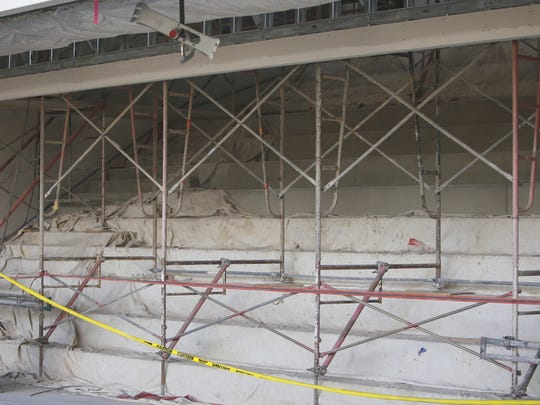 """The new """"amphitheater"""" adjacent to the cafeteria and commons area at the new Farmington High School will offer banked bench seating to students."""