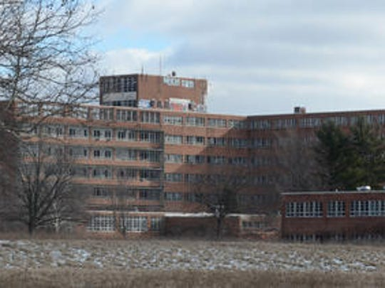 The main building at the former Northville Psychiatric Hospital property in Northville Township is scheduled to be cleaned of asbestos and torn down at a cost of about $5.9 million. Trespassing at the site has dropped dramatically in recent months.