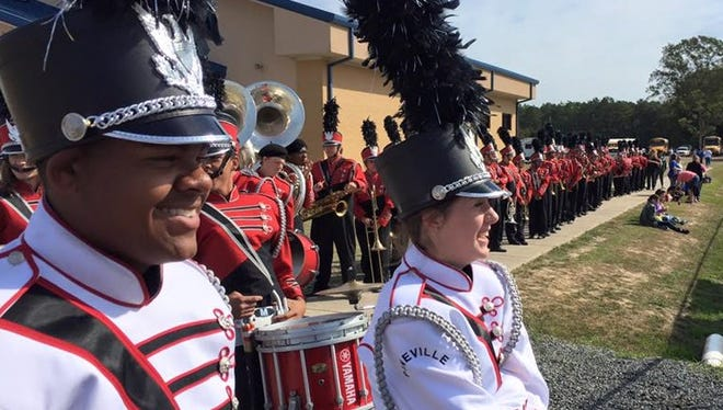 Haleigh Gardner (right) is the Pineville High School marching band drum major. She was selected to march in the Macy's Thanksgiving Day Parade in New York City with the Great American Marching Band.